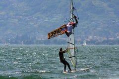 Freestyle kiteboarder on lake  Stock Photos