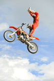 Freestyle moto-x air. A freestyle moto-x rider flying through the air on his motorcycle doing a trick stock photos