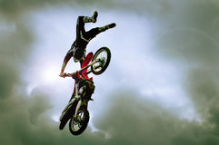 Freestyle motorcycle. Man in the air on freestyle motorcycle Stock Image