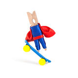 Freestyle skateboarding concept. Clothespin superhero coach skateboarder and extreme sport action. Blue skate board with Stock Photography