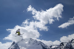 Freestyle ski jumper with crossed skis Royalty Free Stock Photo