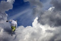 Freestyle ski jumper with crossed skis stock photo