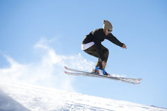 Freestyle ski jumper with crossed skis Royalty Free Stock Images