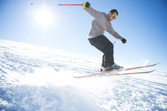Freestyle ski jumper with crossed skis Royalty Free Stock Photos