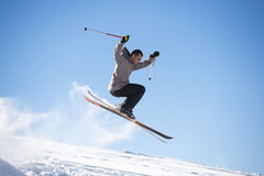 Freestyle ski jumper with crossed skis Stock Photos