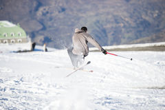 Freestyle ski jumper with crossed skis Stock Image