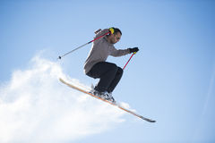 Freestyle ski jumper with crossed skis Stock Photography