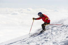 Freestyle skier skiing. Sofia, Bulgaria - March 12, 2016: Freestyle skier is skiing at the top of a snowy peak of Vitosha mountain covered in clouds. He is stock photo