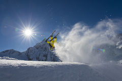 Freestyle skiing - ski cross - acrobat in action. Jumping ski in a half pipe Stock Photos