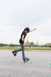 Freestyle slalom. Heel wheeling difficult trick, Girl skating with cone, freestyle slalom skate stock photography
