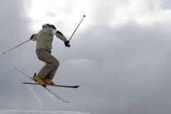 Freestyle. Snow Skier Jumping. Over sky Stock Image