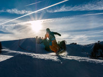 Freestyle snowboarder with helmet in snowpark Royalty Free Stock Photo