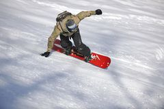Freestyle snowboarder jump and ride Royalty Free Stock Photography
