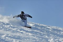 Freestyle snowboarder jump and ride Stock Images