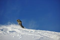 Freestyle snowboarder jump and ride Stock Photo