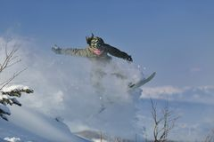 Freestyle snowboarder jump and ride Stock Image