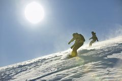 Freestyle snowboarder jump and ride Stock Photos