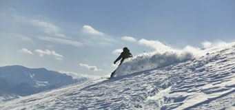 Freestyle snowboarder jump and ride Royalty Free Stock Image