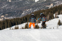 Freestyle snowboarders with helmet in snowpark, twins Stock Image