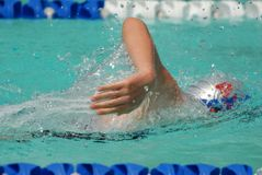 Freestyle swimmer. Powering ahead in a race Stock Photo
