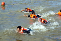 Freestyle swimming. A freestyle swimming competitions with life jackets in conjunction with the Sarawak Regatta 2010. Regatta is an annually events of the Stock Photos