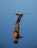 Freestyle Training. A freestyle skier trains in the summer off-season by doing aerial tricks into a pool Stock Images