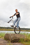 Freestyle trial rider exercising Stock Images