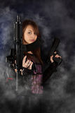 Freestyle woman posing with guns. Shot of a sexy freestyle woman posing with guns Royalty Free Stock Image