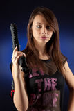 Freestyle woman posing with guns Stock Photos