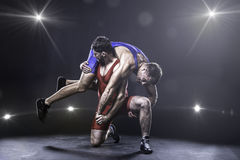 Freestyle wrestler throwing Stock Photography