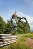 Freestyle young male jumping from concrete blocks. Stock Photo