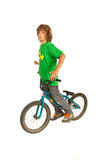 Freestyler biker teen boy. On the bike isolated on white background Stock Image