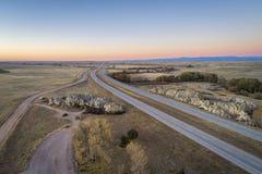 Freeway across rolling prairie royalty free stock images