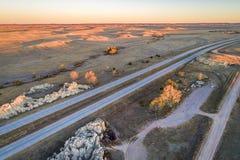 Freeway across rolling prairie stock photo