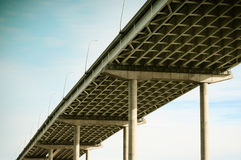 Freeway bridge. Multiple line highway bridge overpass with supporting beams royalty free stock photo