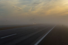 Freeway and a car in fog Stock Image