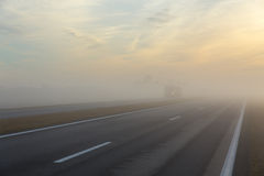 Freeway and a car in fog Royalty Free Stock Photos