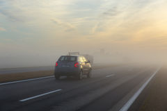 Freeway and a car in fog Royalty Free Stock Images
