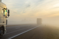Freeway and a car in fog Stock Images