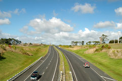 Freeway in the Country. Cars on blacktop freeway royalty free stock image