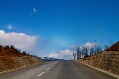 Freeway in the mountain peak Royalty Free Stock Image