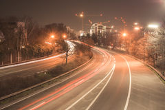Freeway at night. The freeway B7 next to the city Dusseldorf heading south. At night, in long-time exposure Royalty Free Stock Photos