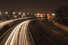 Freeway at night. The freeway B7 next to the city Dusseldorf heading south. At night, in long-time exposure Royalty Free Stock Photo