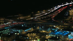 Freeway at night. A time lapse of a tilt shift view over a freeway interchange at night stock footage