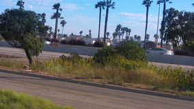 Freeway off ramp traffic in California stock footage