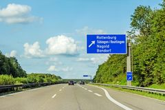 Freeway road sign on Autobahn A81, Herrenberg - Rottenburg. Motorway road sign on Autobahn 81 / A 81 / E 531 direction to city Herrenberg / Stuttgart - exit Royalty Free Stock Images