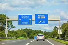 Freeway road sign on Autobahn A81, Karlsruhe / Heilbronn - exit Munich / Airport / Mess Stock Photos