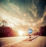 Freeway roadside sunset Stock Image
