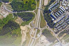 Freeway and roundabout pattern with traffic aerial. Shot in Stockholm, Sweden stock images