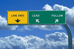 Freeway sign reading Lead or Follow stock image